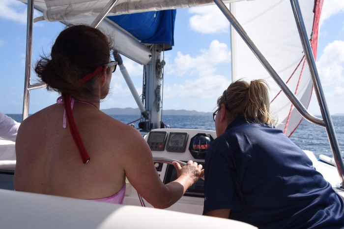 Becky at helm with Amanda-700x465